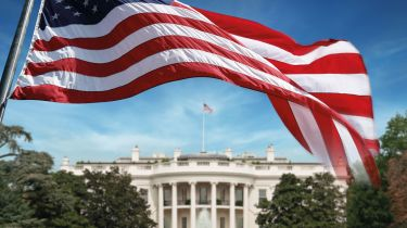 US flag in front of the White House