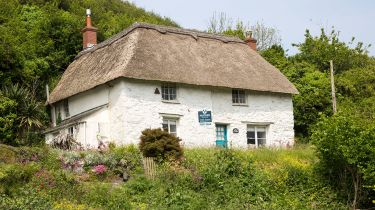 Country cottage for sale ©Geography Photos/Universal Images Group via Getty ImagesCountry cottage for sale ©