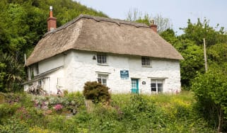 Country cottage for sale © Geography Photos/Universal Images Group via Getty ImagesCountry cottage for sale ©