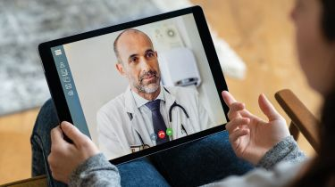 A doctor on a video call © Getty Images/iStockphoto