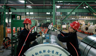 Workers in a Chinese steel factory