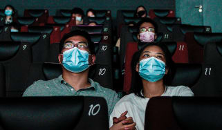 Masked cinema-goers