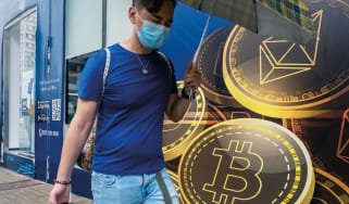 A pedestrian walking past a Hong Kong cryptocurrency exchange