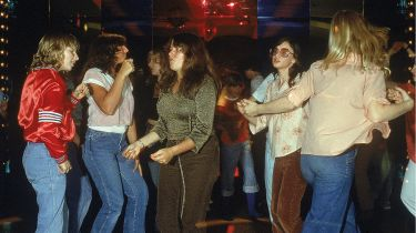 Groovy chicks dancing in a 1970s disco