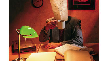 Man with a paper bag on his head ©