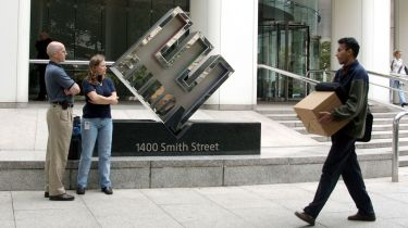 Enron employees leave the company's HQ