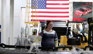 Worker on a car production line