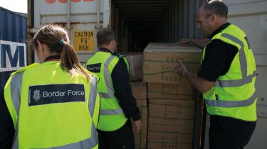 UK Border Force official inspecting a shipping container