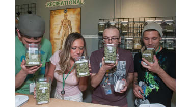 People smelling jars of cannabis © iStockphotos