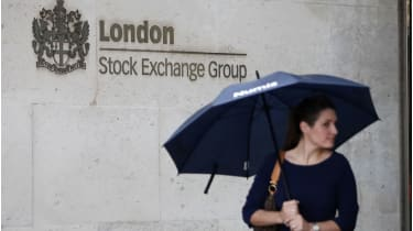 Woman outside the London Stock Exchange © AFP via Getty Images
