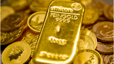 Gold bars and coins © Photothek via Getty Images