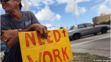 Man asking for work © Joe Raedle/Getty Images