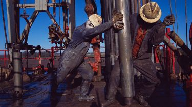 Oil workers © Greg Smith/Corbis via Getty Images