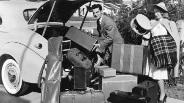 A 1930s couple packing to go on holiday