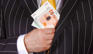 Suit pocketing a wad of cash