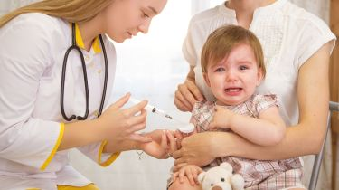 doctor giving a crying child an injection © Getty Images/iStockphoto