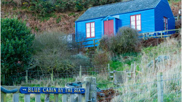 Blue Cabin by the Sea is reached via a secret smuggler's tunnel © Sally Anderson/Alamy