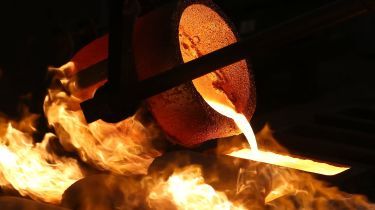 Molten gold being poured from a crucible