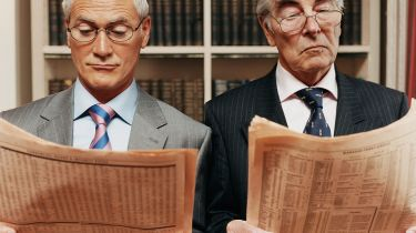 Two men reading the FT