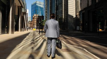 Businessman on an empty street in the City © Jason Alden/Bloomberg via Getty Images
