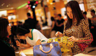 Chinese woman shopping for handbags