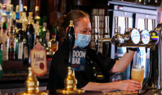 Barmaid pouring a pint