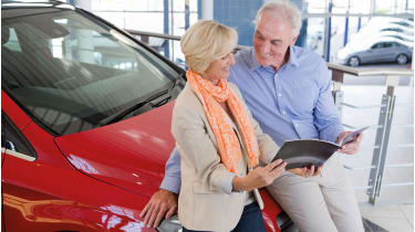 Old people looking at a car brochure © Juice Images / Alamy Stock Photo