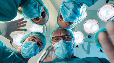 Looking up at some surgeons © Getty Images