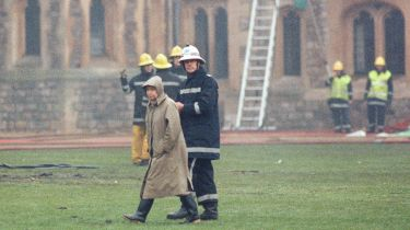 Queen Elizabeth surveys the damage at Windsor Castle after it caught fire