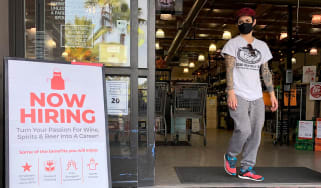 """Now hiring"" sign in a US shop"