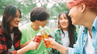young people drinking something