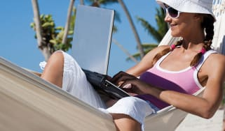 Woman in a hammock with a laptop