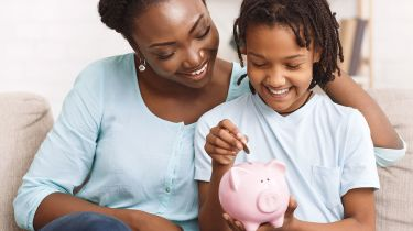 Mother, child and piggy bank