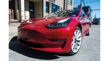 Tesla Model 3 plug-in electric car © iStockphotos