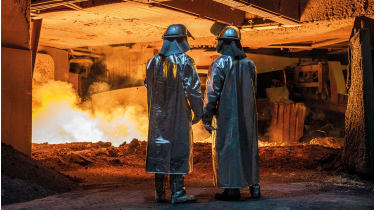 Steel workers at a blast furnace © Maja Hitij/Getty Images