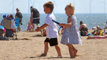 Children walking on a beach