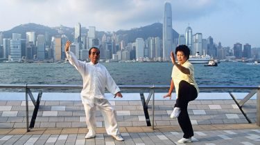 People practising Tai Chi in Hong Kong © Alamy