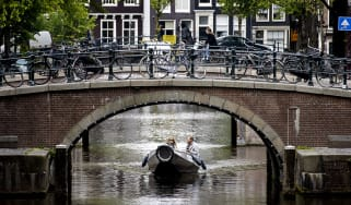 Canal in Amsterdam © KOEN VAN WEEL/ANP/AFP via Getty Images