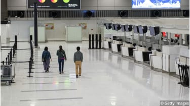 Empty check-in desks at Narita Airport © Carl Court/Getty Images
