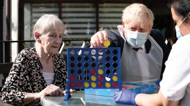 Boris Johnson playing Connect 4 with an old lady