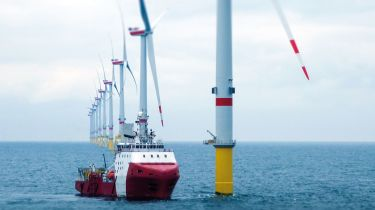 Boat at an offshore windfarm ©Getty