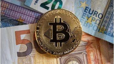 Bitcoin on euro notes © NurPhoto/NurPhoto via Getty Images