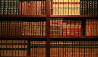bookcase full of old leather-bound books