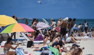 People on Miami Beach © AFP via Getty Images
