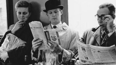 Man reading Lady Chatterley's Lover on a train © Fox Photos/Hulton Archive/Getty Images