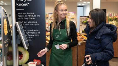 Marks & Spencer staff and customer © Marks & Spencer