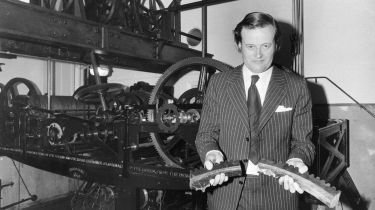 Robin Cooke, chair of administration at the House of Commons, holding broken parts of the clock © Central Press/Getty Images