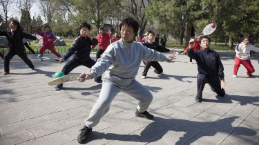 Chinese pensioners doing tai chi