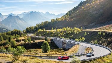 Fast cars on a mountain road