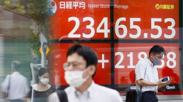 A stock monitor in Tokyo shows the Nikkei Stock Average © Kyodo News via Getty Images